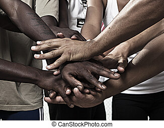 Hands together in union - Closeup portrait of group with...