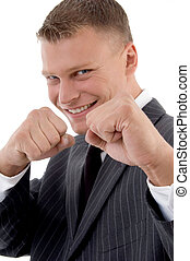 smiling professional showing boxing gesture on an isolated...