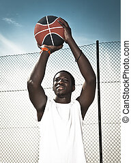 Playing basketball - Portrait of a afroamerican man playing...