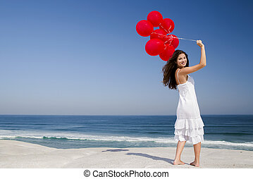 Beautiful girl holding red ballons - Beautiful girl with red...