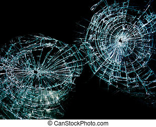 two holes - Broken or shattered glass with two holes, on...