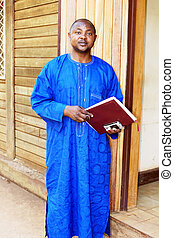 African business man in blue traditional or ethnic clothes.
