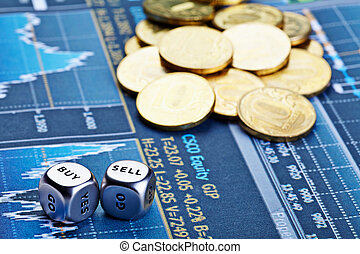 Dices cubes with words BUY SELL, coins and  financial chart as the background. Dices for traders. Selective focus