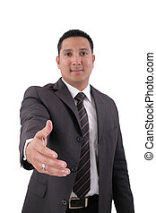 A business man with an open hand ready to seal a deal.  Focus in the hand.