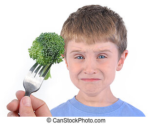 Boy and Healthy Broccoli Diet on White - A young boy is...