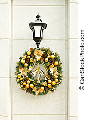 Christmas wreath on lantern on white wall. - Beautiful...