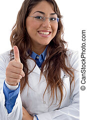 smiling doctor showing thumbs up on an isolated background