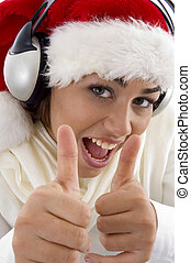 woman wearing christmas hat and showing thumbs up on an...