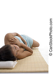 side view of young woman in relaxation pose