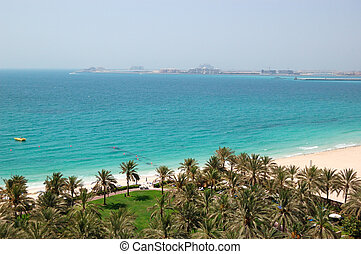 Beach with a view on Jumeirah Palm man-made island, Dubai, UAE