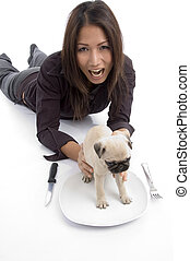 woman putting puppy in plate