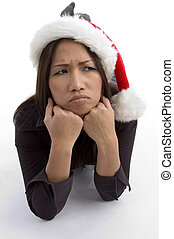 christmas hat wearing female in sad mood on an isolated...