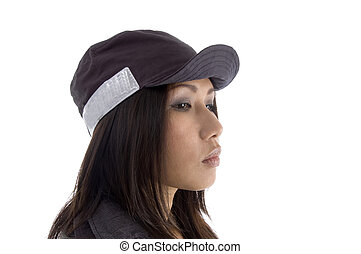 side pose of female wearing security cap