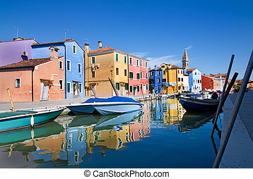Venice, Burano island, small brightly-painted houses and...