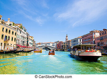 Venice Grand canal with gondolas and Rialto Bridge, Italy in...