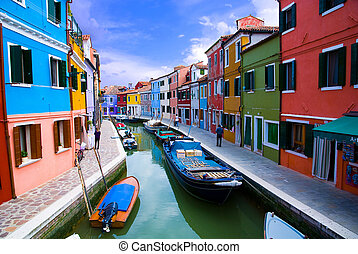 Venice, Burano island canal, small colored houses and the...