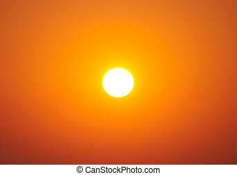 Bright big sun on sky with yellow orange gradient colors -...