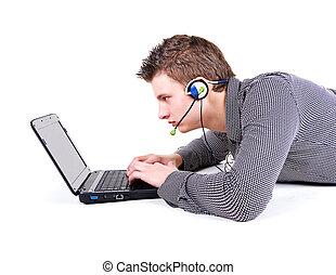 Young man communicate in internet in headset with a...