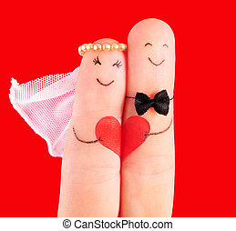 wedding concept, newlyweds with heart against red background...
