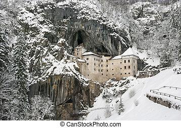 Predjama castle in the winter, Slovenia - Predjama castle -...
