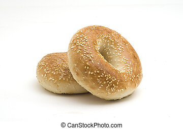 Sesame Seed Bagels - Two sesame seed bagels on a white...