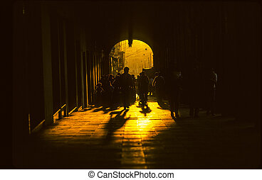 Indio people passing the gate at the central market place in...