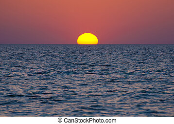 Bright sunset under the sea with yellow red gradient colors