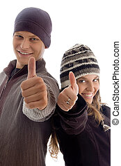 young couple showing thumbs up with white background