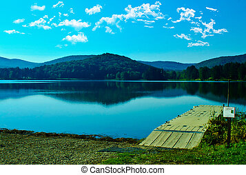 Mountain Lake Dock - Majestic mountains and billowing clouds...