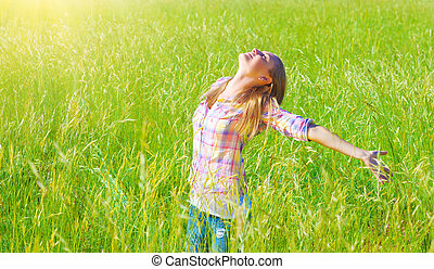 Woman having fun outdoor, enjoying fresh air and spring...