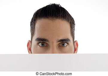 man peeping over placard on an isolated white background