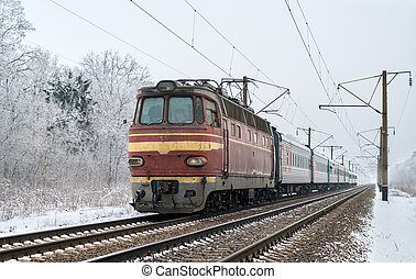 Passenger train hauled by electric locomotive. Ukrainian...