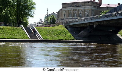 mindaugas bridge people - Mindaugas bridge through river...