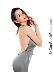 Sexy brunette in grey dress showing her naked shoulder...