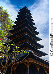 Traditional Balinese many tier palm roof in the temple
