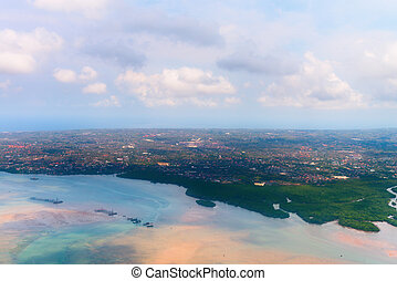 Aerial view of Denpasar on Bali showing buildings andmangrove forest