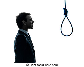 one caucasian business man portrait profile standing  in front of hangman's noose in silhouette studio isolated on white background