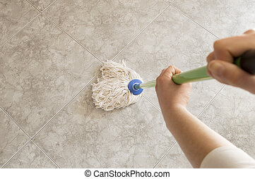 floor scrubbing with a mop seen from above