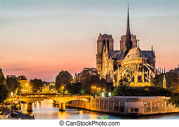 notre dame de paris and the seine by night river France