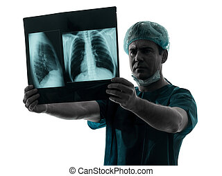 doctor surgeon radiologist examaning lung torso x-ray image...