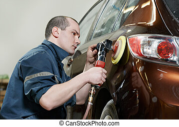 auto mechanic polishing car - auto mechanic worker polishing...