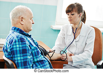 nurse at Blood pressure medic test - doctor nurse measuring...