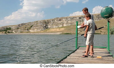 Father and Son Fishing - Father and son fishing together by...