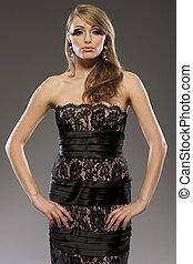 beautiful blond model in black dress