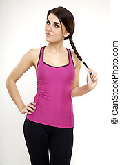 sporty woman in violet dress standing and looking on camera
