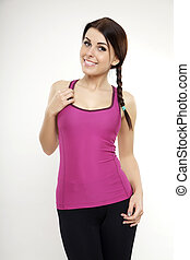 sporty woman in violet dress standing and looking on camera...