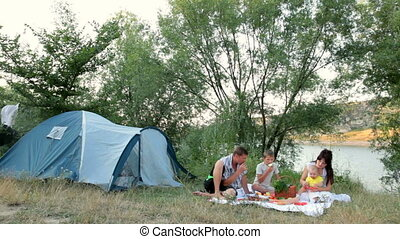 Family summer camping vacation - Young family with two...