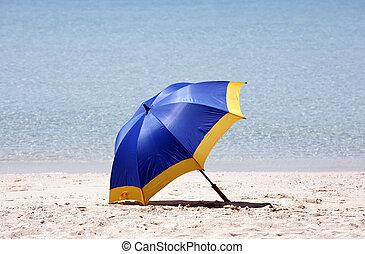 Beach umbrella - Blue beach umbrella on a beach