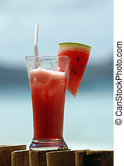 water-melon juice - Glass with water-melon juice on a...