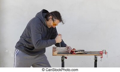 Carpenter at work with file